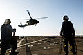 U.S. Sailors stand by as an Army UH-60 Black Hawk medevac helicopter assigned to Charlie Company, 2nd Battalion, 238th Aviation Regiment and attached to the 42nd Combat Aviation Brigade (CAB), New York Army 131226-Z-AR422-045.jpg