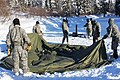U.S. Soldiers assigned to the 4th Brigade Combat Team (Airborne), 25th Infantry Division, work to assemble an Arctic 10-man tent as part of the Cold Weather Orientation Course at the Northern Warfare Training 130327-A-FZ028-004.jpg