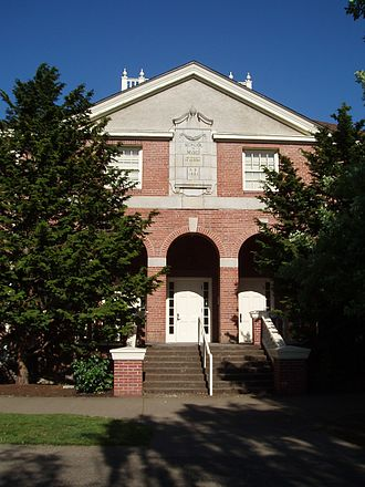"""MarAbel B. Frohnmayer Music Building - West facade of the Frohnmayer Music Building, at the entrance to Beall Hall. The inscription over the entrance reads """"School of Music - University of Oregon - AD 1921."""""""