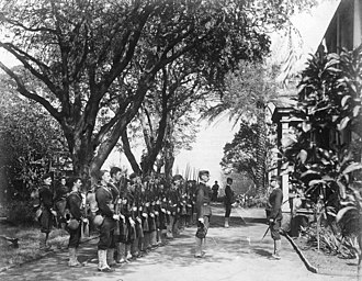 Overthrow of the Kingdom of Hawaii - The USS Boston's landing force on duty at the Arlington Hotel, Honolulu, at the time of the overthrow of the Hawaiian monarchy, January 1893. Lieutenant Lucien Young, USN, commanded the detachment, and is presumably the officer at right.
