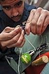 USS Carl Vinson Sailors conduct parachute maintenance 141111-N-TP834-085.jpg