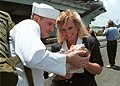 US Navy 020817-N-6913J-002 Sailor is welcomed home by newborn daughter.jpg