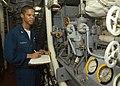 US Navy 030625-N-2819P-007 Machinist's Mate 3rd Class Kemetrick D. Thomas from Shreveport, La., reads and checks generator gauges.jpg