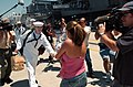 US Navy 040723-N-9288T-279 A Sailor greets his loved after departing USS Ronald Reagan (CVN 76).jpg