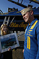 US Navy 051101-N-5328N-038 FOX News anchor, Greta Van Susteren receives an autographed photograph from the Lt. Cmdr. John Allison, assigned to the U.S. Navy Flight Demonstration squadron, the Blue Angels.jpg