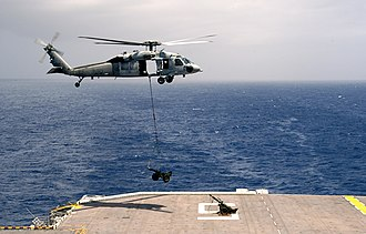 USS Bataan (LHD-5) - USMC M327 mortar air lifted onto the amphibious assault ship USS Bataan by MH-60S Seahawk on 7 June 2006