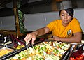 US Navy 060906-N-4856C-005 Gunner's Mate Seaman Juntine R. Velayo from Las Vegas, Nev., prepares the salad bar in the Wardroom Mess aboard the amphibious assault USS Iwo Jima (LHD 7).jpg