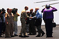 US Navy 070511-N-2659P-196 Vice President Dick Cheney is greeted by Capt. Brad Johanson, commanding officer of USS John C. Stennis (CVN 74), after passing through side boys on the flight deck of Nimitz-class aircraft carrier US.jpg