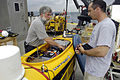 US Navy 070612-N-7676W-147 Gene Latham, left, and Joseph Curcio from the Massachusetts Institute of Technology, prepare Scout, an autonomous surface platform, for deployment as part of Autonomous Underwater Vehicle (AUV) Fest 2.jpg