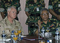 US Navy 071123-N-8623G-025 Adm. Timothy J. Keating, commander of U.S. Pacific Command, and Lt. Gen. Masud Uddin Choudhury, Principal Staff Officer to the Prime Minister, listen to a disaster brief on the Cyclone Sidr.jpg