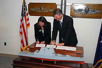 Zumwalt-class destroyer - Representatives from Naval Sea Systems Command and Bath Iron Works sign a construction contract at the Pentagon, February 2008.