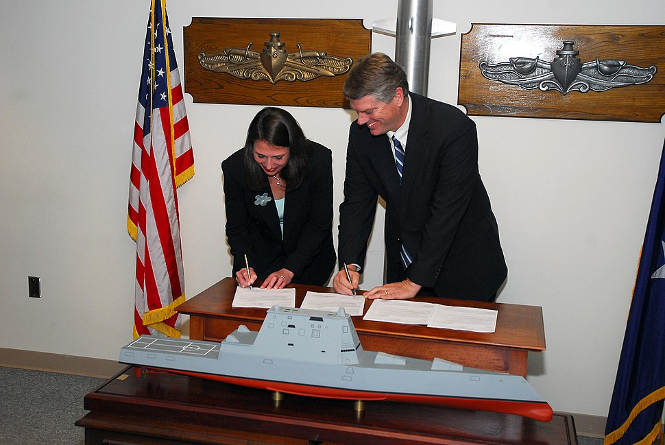 US Navy 080214-N-0923G-001 Susan Tomaiko, left, and Brian Cuccias, vice president and DDG 1000 program manager for Northrup Grumman Shipbuilding, sign the $1.4 billion construction contract for the DDG 1000 Zumwalt Class destro