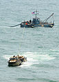 US Navy 080713-N-1424C-320 Members of Beach Master Unit (BMU) 1 drag offshore petroleum discharge system conduit hose to shore during Joint Logistics Over-The-Shore (JLOTS) 2008.jpg