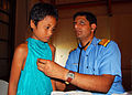 US Navy 080826-N-6387D-033 Indian Navy Surgeon Cmdr. Ranjeet Thergaonkar, MD, examines a 9-year-old girl.jpg