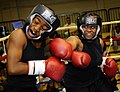 US Navy 081011-N-5345W-057 Cryptologic Technician Networks Seaman Janea Arrington connects with a straight right to the jaw of Aviation Ordnanceman Airman Nakita Boyd during a sparring session.jpg
