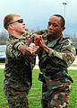 US Navy 090212-N-4044H-059 Master-at Arms Seaman Martavius Eackles, assigned to Naval Support Activity Naples, performs a basic weapons takeaway maneuver on Marine Corps Sgt. Albert Tippett.jpg