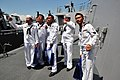 US Navy 090513-N-1488S-017 Ship's Serviceman Seaman Aaron Seeda, left, and Electronics Technician 1st Class Michael Wolfe, second from the right, give a tour aboard USS Kidd (DDG 100) to Sailors from the Thai Navy ship HTMS Suk.jpg