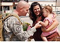 US Navy 090804-N-4698K-010 Aviation Electronics Technician 1st Class Robert Lovett greets his wife and daughte.jpg