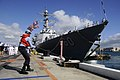 US Navy 090821-N-7498L-083 Seaman Kehmal Nelson, from New York, secures mooring lines as the guided-missile destroyer USS Paul Hamilton (DDG 60) returns to homeport at Naval Station Pearl Harbor.jpg