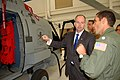 US Navy 091112-N-9402B-002 Cmdr. Scott Walsh shows U.S. Sen. George LeMieux the cabin of the new SH-60R Romeo helicopter.jpg