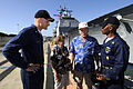 US Navy 091208-N-7498L-005 Executive Officer Cmdr. William Baxter and Command Master Chief Herbert Ellis give a tour of USS Port Royal (CG 73) to Woody Derby, a Pearl Harbor survivor.jpg