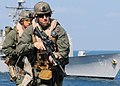 US Navy 100210-N-5538K-055 Staff Sgt. Chad Charlton, a member of the 31st Marine Expeditionary Unit (31st MEU) visit, board, search and seizure team leads team members to the bridge of the forward-deployed amphibious transport.jpg
