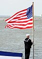 US Navy 100327-N-3154P-068 A Sailor raises the National Ensign during a commissioning ceremony aboard the Virginia-class attack submarine Pre-Commissioning (PCU) New Mexico (SSN 779).jpg