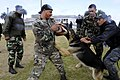 US Navy 101117-N-8546L-641 U.S. Navy Chief Master-at-Arms Nick Estrada, second from right, a military working dog handler from Orange, Calif.jpg