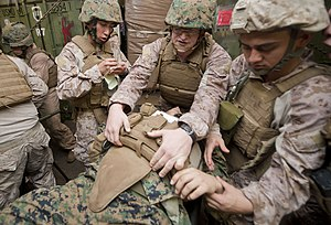 US Navy 111209-N-PB383-226 ospital corpsmen assigned to the 11th Marine Expeditionary Unit (11th MEU) assess a simulated casualty in the well deck.jpg