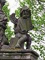 Uhříněves, socha svatého Jana Nepomuckého, andílek s knihou.jpg