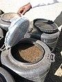 Urea treatment taking place in closed bins (6881900533).jpg