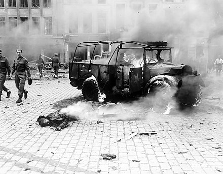 One of the victims of a V-2 that struck Teniers Square, Antwerp, Belgium on 27 November 1944. A British military convoy was passing through the square at the time; 126 (including 26 Allied soldiers) were killed. V-2victimAntwerp1944.jpg