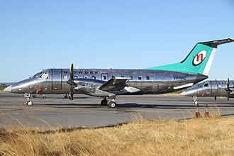 Network Aviation - Embraer EMB-120ER in polished aluminium livery at Perth Airport in 2012