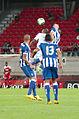 Valais Cup 2013 - OM-FC Porto 13-07-2013 - Herrera à la lutte avec André Ayew sous les yeux de Danilo et Maicon 1.jpg