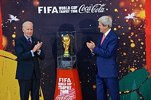 Vice President Joe Biden and Secretary of State John Kerry applaud the FIFA World Cup trophy at the U.S. Department of State.jpg