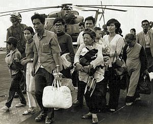 Non-combatant evacuation operation - South Vietnamese refugees arrive on a U.S. Navy vessel during Operation Frequent Wind in 1975.