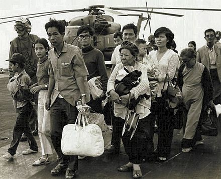 South Vietnamese refugees arrive on a U.S. Navy vessel during Operation Frequent Wind Vietnamese refugees on US carrier, Operation Frequent Wind.jpg