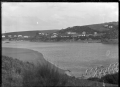 View of Taieri Mouth, with bridge over the river in right foreground ATLIB 274019.png