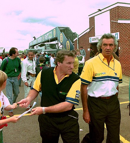 Walkinshaw (left) with Flavio Briatore at the 1993 British Grand Prix Walkinshaw Briatore British GP 1993.jpg