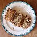 Walnut-Bourbon Banana Bread loaf and slices on a plate.jpg