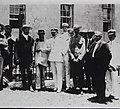 Walter Wyman, Joseph Dutton, and others at Father Damien's grave.jpg