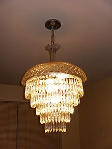 a fivetier wedding cake chandelier with a crystal top