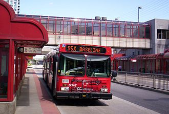 OC Transpo Route 95 - A Route 95X Baseline articulated bus at Westboro Station