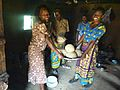 Women happily showing off their ugali.JPG