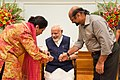 Women tying 'Rakhi' on the Prime Minister, Shri Narendra Modi's wrist, on the occasion of 'Raksha Bandhan', in New Delhi on August 07, 2017 (2).jpg