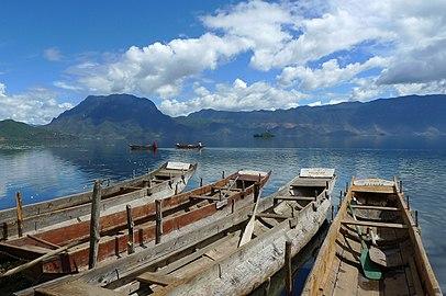 Wooden boats at Lugu Lake (Luguhu Nature Reserve with WDPA ID 95771).jpg