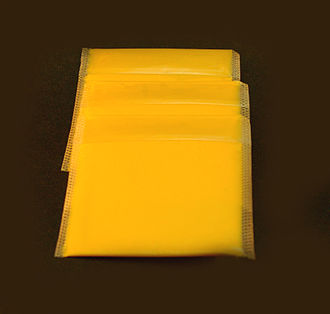 Processed cheese - American cheese is a processed cheese. Pictured are wrapped slices.