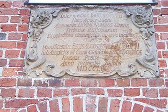 Worpswede - Plaque in Latin commemorating George II as principal of the Church of Zion building, hanging on its outside wall