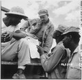 """... troops in Burma stop work briefly to read President Truman's Proclamation of Victory in Europe."" - NARA - 531341.tif"