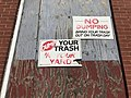 """""""No Dumping"""" sign on boarded window of vacant rowhouse, 2446 E. Chase Street, Baltimore, MD (48818655347).jpg"""